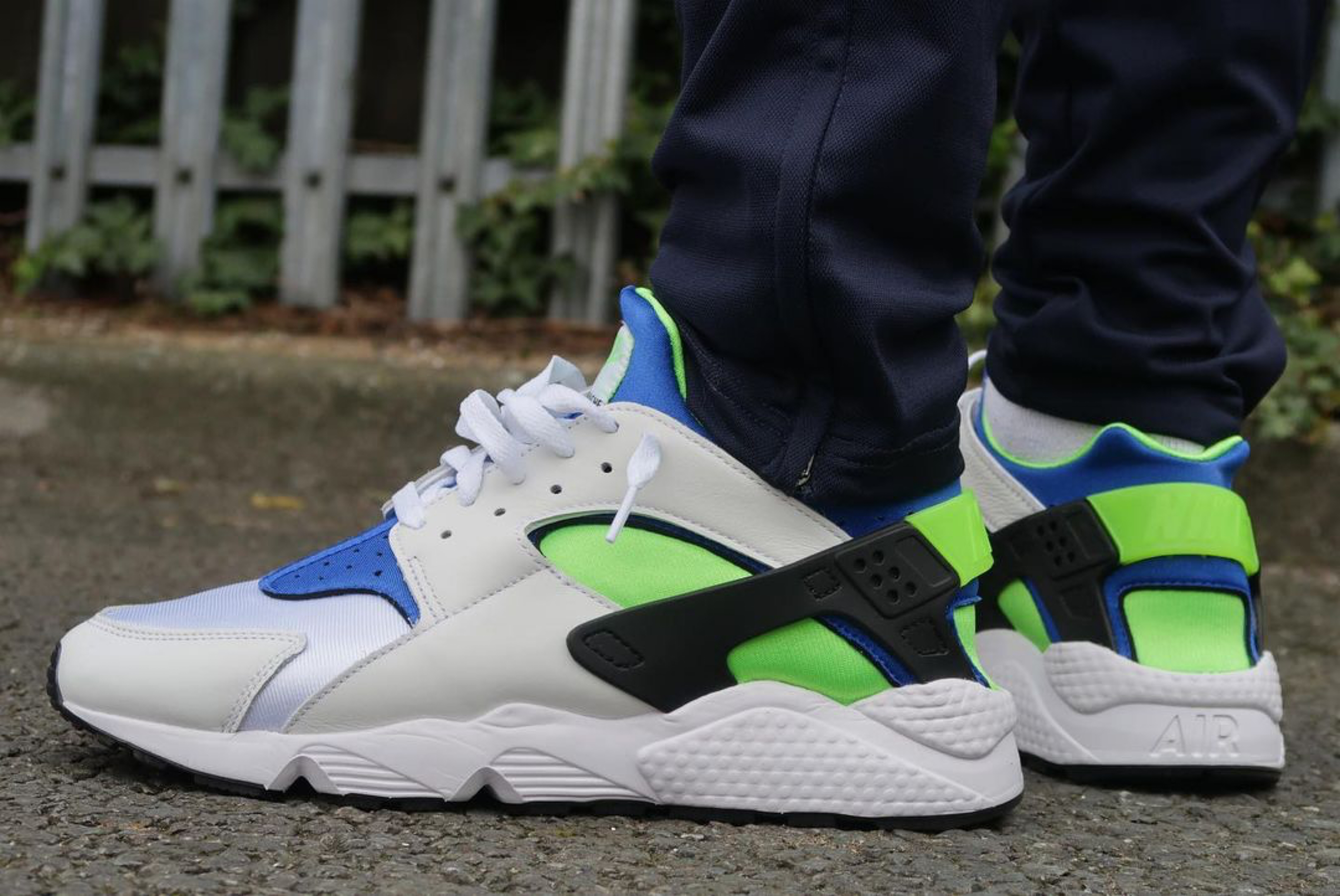 Nike huarache scream green on feet